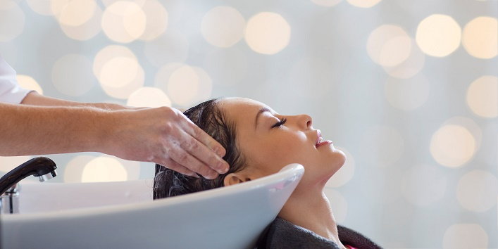 beauty salon, hair care and people concept - hairdresser hands w