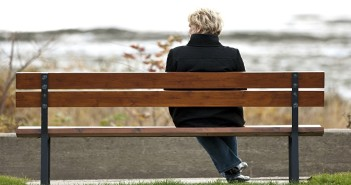 Woman sitting alone on park bench